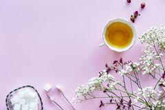 White and Purple Flowers With White Tea Cup Containing Yellow Liquid stock photos