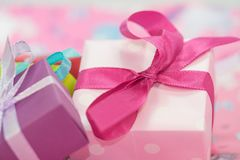 White and Purple Gift Box With Pink and White Ribbon Stock Images