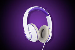 White and purple padded headphones isolated on purple Stock Photos
