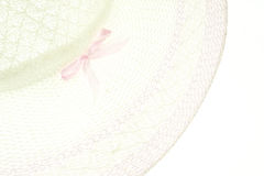 White and purple Weave hat with pink bow isolated Royalty Free Stock Photo