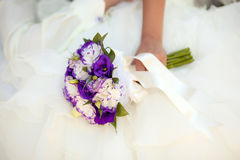 White and purple wedding bouquet with eustomas in hands. Colorful wedding bouquet with eustomas  in bride's hands Royalty Free Stock Photos