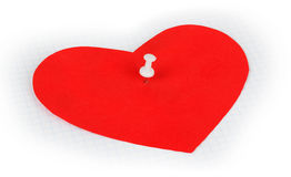 White push pin in red heart Royalty Free Stock Photography