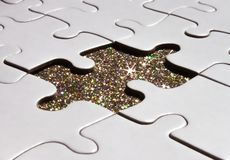 White puzzle on sparkle background royalty free stock photos