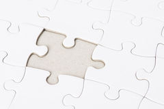 White puzzle with one missing piece Royalty Free Stock Photos