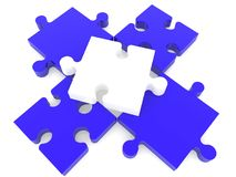 White puzzle piece on four connected blue puzzle pieces. In backgrounds Royalty Free Stock Photography