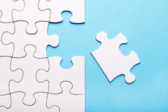 White puzzle piece missing. On blue background stock images