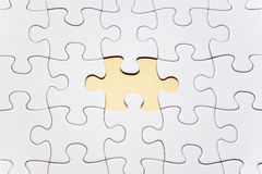 White puzzle shown with one piece missing Royalty Free Stock Image