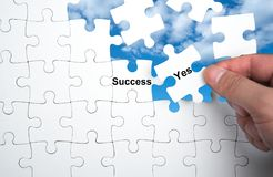 Success and Yes word. White puzzle with Success and Yes word, business concept Stock Photos