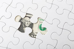 White puzzle and US banknote Royalty Free Stock Photo