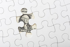 White puzzle with USD Royalty Free Stock Photography