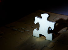 White puzzles. On dark background Stock Photography