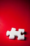 White puzzles. On red background Stock Photos