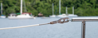 White PVC Coated Lineline, Gate and Stanchion on Sailboat Stock Photos