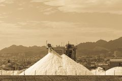 White pyramids with natural sea salt, salt works on factory near royalty free stock photography