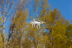 White quadcopter steams in air. Ukraine, Kyiv 25 april 2017 quadcopter flies takes off video and photo from air,white quadcopter steams in air Stock Photography