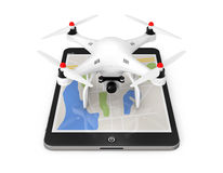 White Quadrocopter drone with Photo Camera over Tablet PC. 3d Re. White Quadrocopter drone with Photo Camera over Tablet PC on a white background. 3d Rendering Royalty Free Stock Images