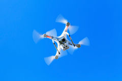 White quadrocopter in sky, under wireless control Stock Image