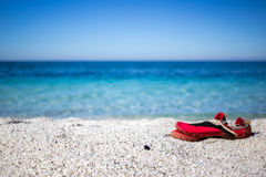 White quartz Is Arutas beach and red slippers Stock Image