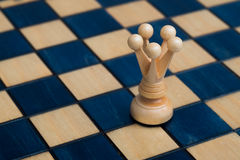 White queen on wooden chessboard Royalty Free Stock Image