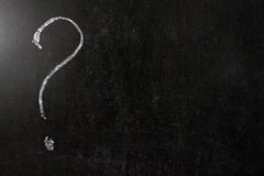White question mark. Question mark drawn in chalk on a blackboard. white question mark in the left corner on black background stock images