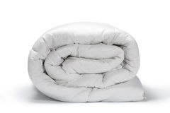 White quilt. Warm and confortable folded white quilt on white background Stock Photo