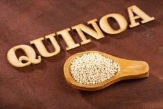 White Quinoa Seeds - Chenopodium quinoa. Wood background stock photo