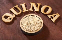 White Quinoa Seeds - Chenopodium quinoa. Wood background royalty free stock images