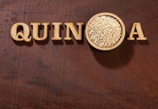 White Quinoa Seeds - Chenopodium quinoa. Wood background stock images