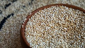 Free White Quinoa Seeds On A Black Background. Quinoa In Bowl On Kitchen Table Top View. Healthy And Diet Superfood Product. Royalty Free Stock Photo - 159839035
