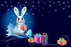White rabbit with gifts Royalty Free Stock Photos