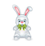 White rabbit with green bow isolated o white Royalty Free Stock Image