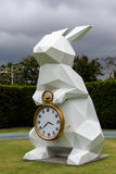 White Rabbit Holding Gold Frame Pocket Watch Statue Royalty Free Stock Photos