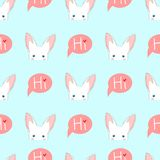 White Rabbit Sneaking on Blue Background Royalty Free Stock Photography