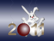 White rabbit symbol east chinese new 2011 year. And new year ball Royalty Free Stock Photo