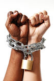 White race hand chain locked together with black ethnicity woman multiracial understanding. White Caucasian hand chained with iron chain and locked together with Royalty Free Stock Photography