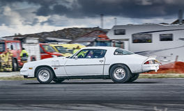 White racing car during the race. Froya, Norway, 24 June 2016: Norwegian high-skill motor sport  competitions and demonstration of fast cars drifting in Norway Royalty Free Stock Image