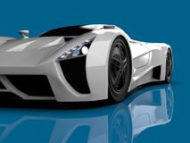 White racing concept car. Image of a car on a blue glossy background. 3d rendering. White racing concept car. Image of a car on a blue glossy background. 3d Royalty Free Stock Images