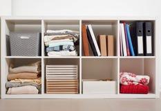 White rack with shelves full of stuff stock photo
