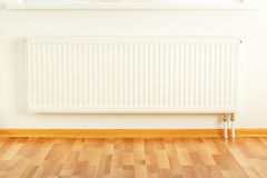 White radiator in apartment Royalty Free Stock Images