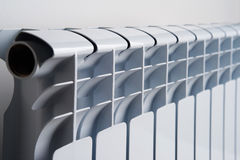 White radiator in an apartment Royalty Free Stock Photography