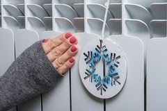 White radiator in the house with symbolic snowflake