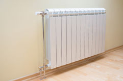 White radiator. In new empty room royalty free stock images