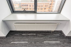 White radiator in the office. Stock Photography