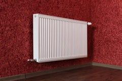 White radiator in red room Stock Photo