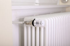 White radiator with white thermostat Royalty Free Stock Images