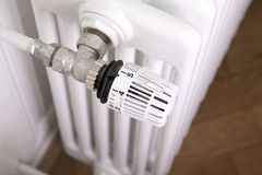 White radiator with white thermostat Royalty Free Stock Photo