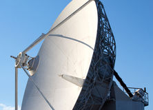White radio telescope against a blue sky Stock Photo