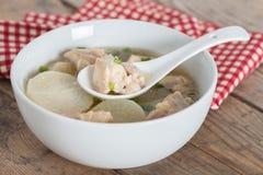 White radish chicken soup in white bowl. Stock Image