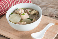White radish chicken soup in white bowl. Stock Photography