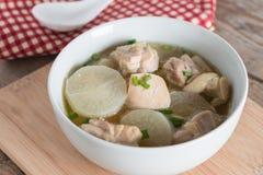 White radish chicken soup in white bowl. Royalty Free Stock Photo